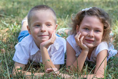 Little boy and the girl lie together on a grass Royalty Free Stock Images