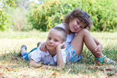 Little boy and the girl lie together on a grass Stock Image
