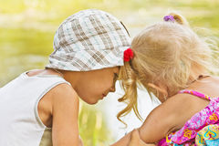 Little boy and girl look at each other Royalty Free Stock Images