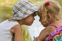 Little boy and girl look at each other Royalty Free Stock Photo