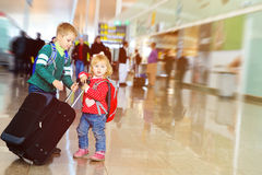Little boy and girl with luggage travel in airport. Kids travel Stock Photo
