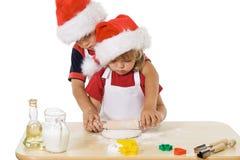 Little boy and girl making christmas cookies Stock Image