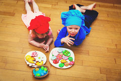 Little boy and girl making easter cookies Stock Image