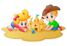 Little boy and girl making sandcastle at beach Stock Photography