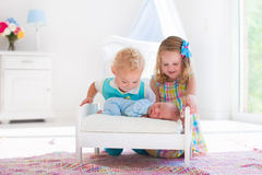 Little boy and girl meet new sibling Stock Photo