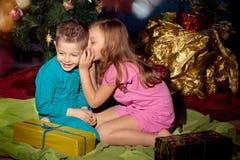 Little boy and girl near Christmas tree Stock Photography