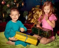 Little boy and girl near Christmas tree Stock Image