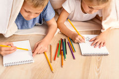 Little boy and girl painting at home Royalty Free Stock Photos