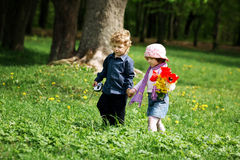 Little boy and girl in the park Royalty Free Stock Photo