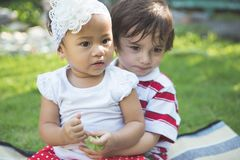 Little boy and girl in the park stock photos