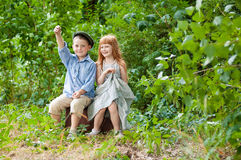 Little boy and girl. Little pigeon pair at a tree Stock Images