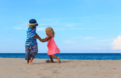 Little boy and girl play on beach Royalty Free Stock Image