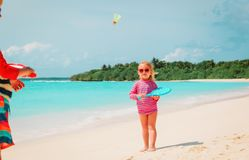 Little boy and girl play beach tennis on vacation. Little boy and girl play beach tennis on sea vacation royalty free stock images