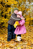 Little boy and girl play in a park in autumn Royalty Free Stock Image