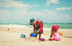 Little boy and girl play with sand on beach Royalty Free Stock Photography
