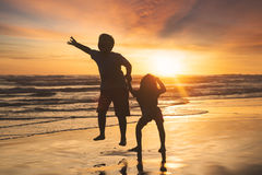Little boy and girl playing on beach Royalty Free Stock Images
