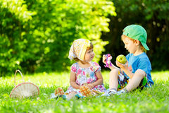 Little boy and girl playing on grass Stock Image