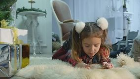 Little boy and girl playing with mobile phones stock video