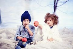 Little boy and girl plays in studio snow forest background Royalty Free Stock Photo