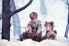 Little boy and girl plays in studio snow forest background Royalty Free Stock Image