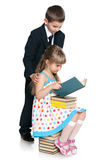 Little boy and girl are reading Stock Images