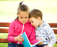 Little boy and girl is reading book Stock Photo