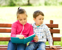 Little boy and girl is reading book Royalty Free Stock Photos