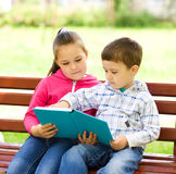 Little boy and girl is reading book Royalty Free Stock Photo