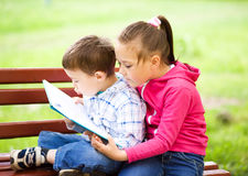 Little boy and girl is reading book Royalty Free Stock Photography