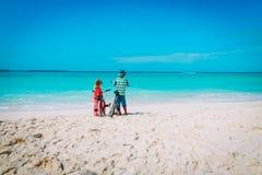 Little boy and girl ride bike on beach. Little boy and girl ride bike on tropical beach Stock Photos