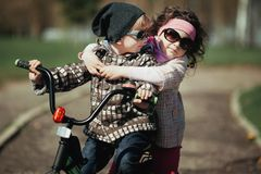 Little boy and girl ride bike Royalty Free Stock Photo