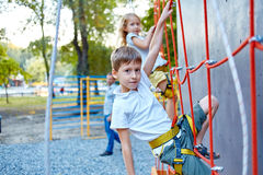 Little boy and girl  in  rock climbing gym Stock Image