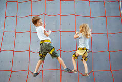Little boy and girl  in  rock climbing gym Stock Photo