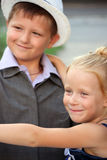 A little boy and girl in a romantic scene Stock Photo