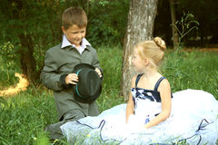 A little boy and girl in a romantic scene Stock Photos