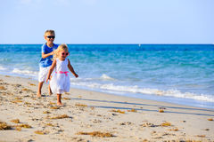 Little boy and girl running at beach Royalty Free Stock Photography