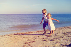 Little boy and girl running at beach Royalty Free Stock Image