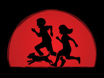 Little boy and girl running together with puppy dog Stock Photo