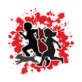 Little boy and girl running together with puppy dog Royalty Free Stock Photo