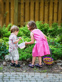 Little Boy and Girl Searching for Easter Eggs Stock Images