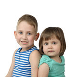 Little boy and girl sit back to back. Isolated on white background Stock Photo