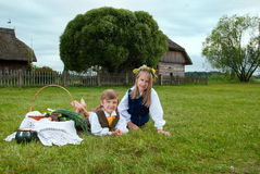 Little boy and girl sitting on a lawn Stock Photo