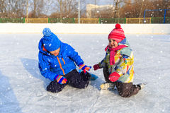 Little boy and girl skating together, kids winter sport Stock Photos