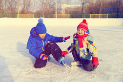 Little boy and girl skating together, kids winter sport Royalty Free Stock Images