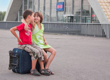 Little boy and girl on the station Royalty Free Stock Photo
