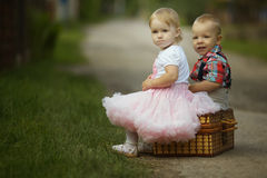 Little boy and girl with suitcase Royalty Free Stock Images