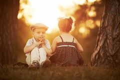 Little boy and girl on sunset Stock Photo