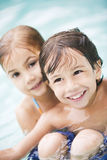 Little boy and girl in swimming pool Stock Photography