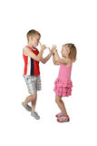 Little boy and girl teasing each other Royalty Free Stock Photo