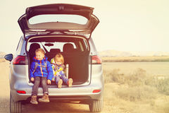 Little boy and girl travel by car in mountains Royalty Free Stock Photo